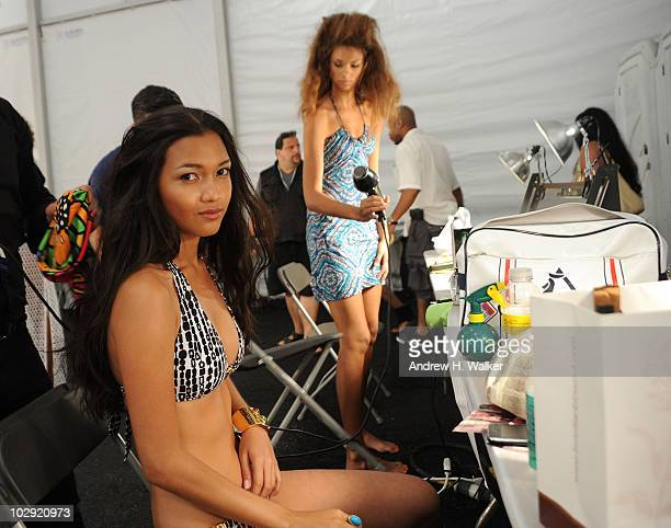 A model prepares backstage at the Trina Turk 2011 fashion show during MercedesBenz Fashion Week Swim at the Raleigh on July 15 2010 in Miami Beach...