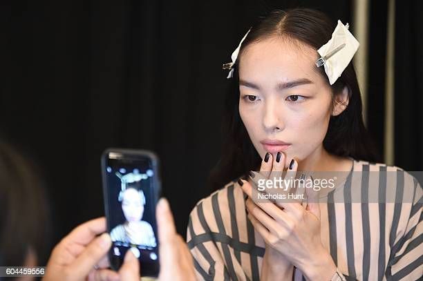 A model prepares backstage at the Vera Wang Collection fashion Show during New York Fashion Week The Shows at The Arc Skylight at Moynihan Station on...