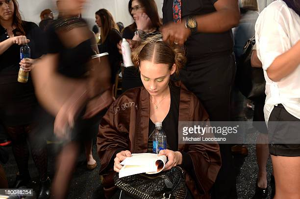 A model prepares backstage at theLela Rose fashion show during MercedesBenz Fashion Week Spring 2014 at The Studio at Lincoln Center on September 8...
