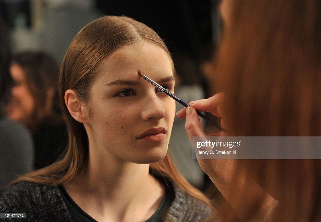 A model prepares backstage at Theyskens' Theory during Fall 2013 Mercedes-Benz Fashion Week at Skylight Studios at Moynihan Station on February 11, 2013 in New York City.
