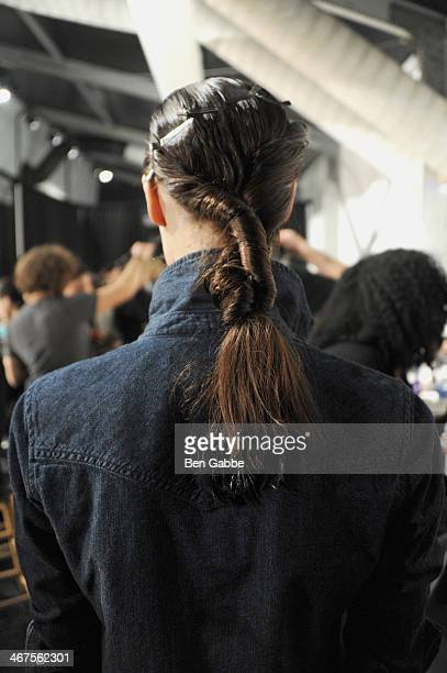 A model prepares backstage at Zimmermann fashion show during MercedesBenz Fashion Week Fall 2014 at The Pavilion at Lincoln Center on February 7 2014...