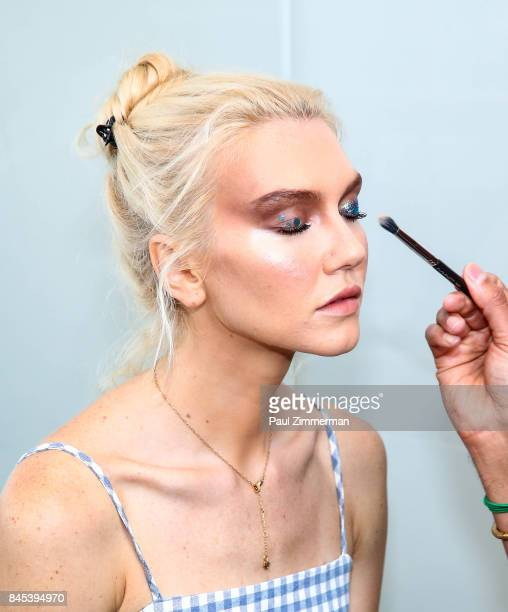 A model prepares backstage athe the Carmen Marc Valvo presentation during New York Fashion Week on September 10 2017 in New York City