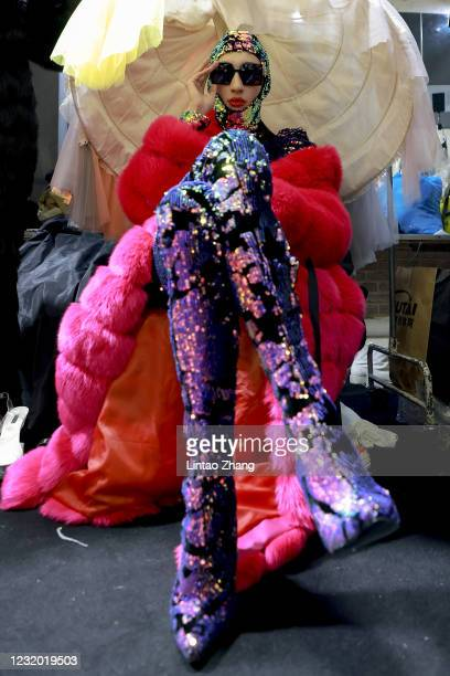 Model prepares backstage before during the YOUG X collection show by Chinese designer Xing Yong on day seven of China Fashion Week A/W 2021/2022 at...