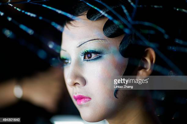 Model prepares backstage before Mao Geping-2016MGPIN Color Make-up Launch Show during the Mercedes-Benz China Fashion Week Spring/Summer 2016 at...