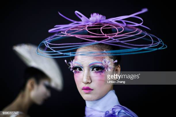 A model prepares backstage before MAOGEPING show by Designer Mao Geping on day two of MercedesBenz China Fashion Week Autumn/Winter 2018/2019 at...