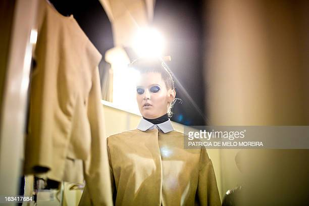 A model prepares backstage before Portuguese designer Alexandra Moura's Autumn/Winter 20132014 collection show during the 40th edition of the Moda...