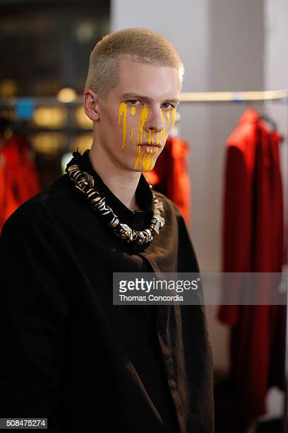 Model prepares backstage before Siki Im fashion show during New York Fashion Week Men's Fall/Winter 2016 at Skylight at Clarkson Sq on February 4,...