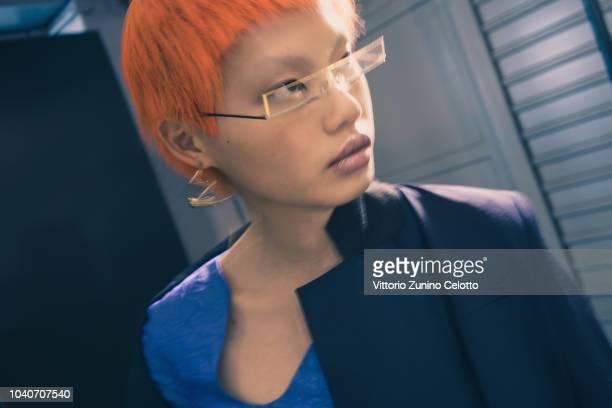 A model prepares backstage before the Aalto show as part of the Paris Fashion Week Womenswear Spring/Summer 2019 on September 26 2018 in Paris France