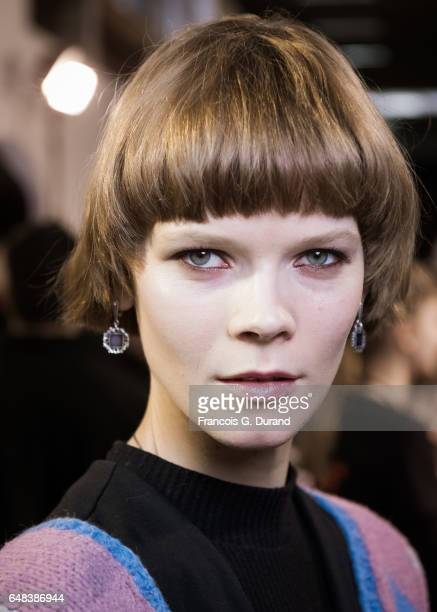 A model prepares backstage before the Akris show as part of the Paris Fashion Week Womenswear Fall/Winter 2017/2018 on March 5 2017 in Paris France