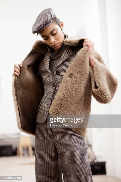 Model prepares backstage before the Akris Womenswear Fall/Winter 2020/2021 show as part of Paris Fashion Week on March 02, 2020 in Paris, France.