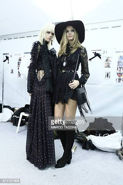 A model prepares backstage before the Elie Saab show as part of the Paris Fashion Week Womenswear Fall/Winter 2016/2017 on March 5 2016 in Paris...