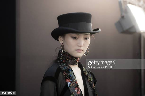 A model prepares backstage before the Elie Saab show as part of the Paris Fashion Week Womenswear Fall/Winter 2018/2019 on March 3 2018 in Paris...