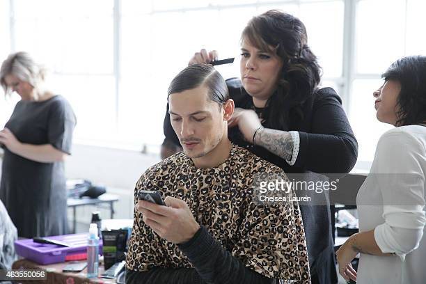 A model prepares backstage before the Franco Lacosta presentation on February 15 2015 in New York City