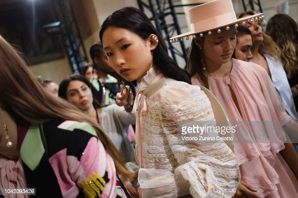 A model prepares backstage before the Ingie show as part of the Paris Fashion Week Womenswear Spring/Summer 2019 on September 27 2018 in Paris France