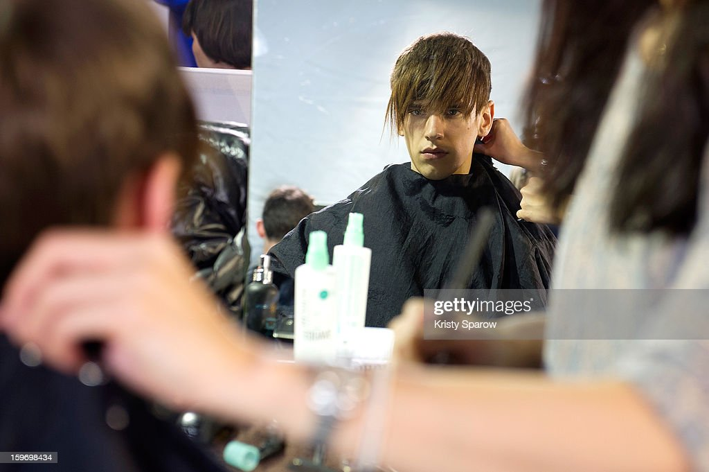 A model prepares backstage before the Krisvanassche Menswear Autumn / Winter 2013/14 show as part of Paris Fashion Week on January 18, 2013 in Paris, France.