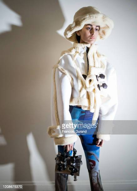 Model prepares backstage before the Ottolinger Womenswear Fall/Winter 2020/2021 show as part of Paris Fashion Week on February 25, 2020 in Paris,...
