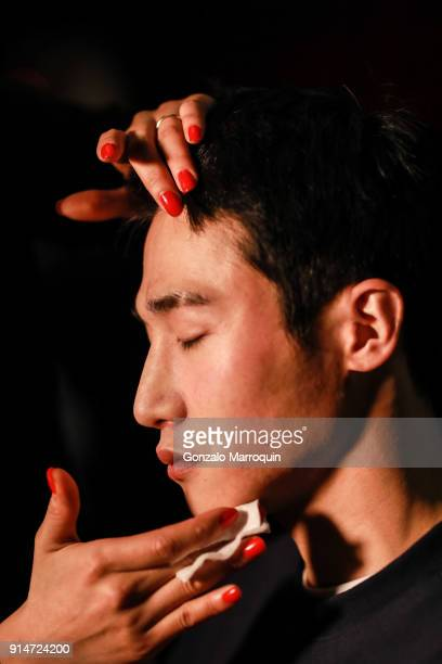 A model prepares Backstage before the Ovadia Sons fashion show on February 2018 New York Fashion Week Mens' at Irving Plaza on February 5 2018 in New...