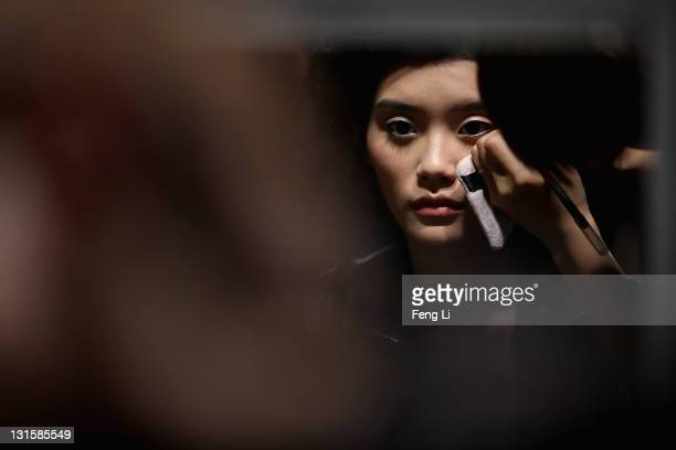 A model prepares backstage before the Salvatore Ferragamo Spring Summer show at the Ullens Centre for Contemporary Art on November 5 2011 in Beijing...