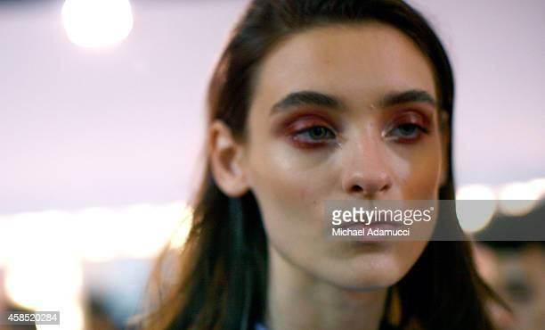 A model prepares backstage before the Teca por Helo Rocha fashion show during Sao Paulo Fashion Week Winter 2015 at Parque Candido Portinari on...