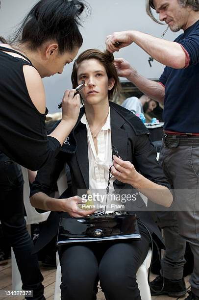 Model prepares backstage before the Veronique Leroy Ready to Wear Autumn/Winter 2011/2012 show during Paris Fashion Week at Palais De Tokyo on March...