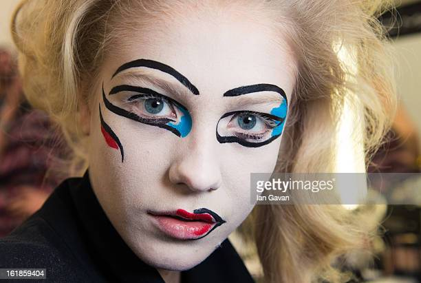 A model prepares backstage before the Vivienne Westwood Red Label show during London Fashion Week Fall/Winter 2013/14 at the Saatchi Gallery on...