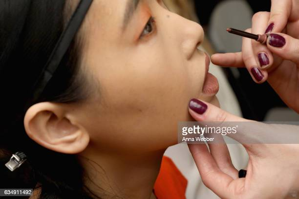 A model prepares backstage during Mary Kay at Tracy Reese F/W'17 presentation and backstage on February 12 2017 in New York City