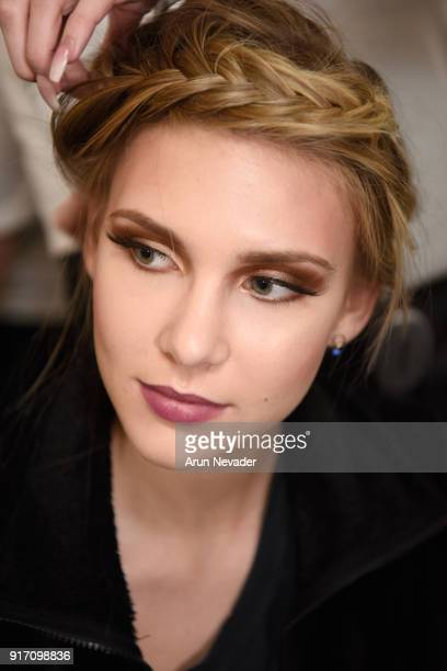 A model prepares backstage during New York Fashion Week Powered by Art Hearts Fashion NYFW at The Angel Orensanz Foundation on February 11 2018 in...