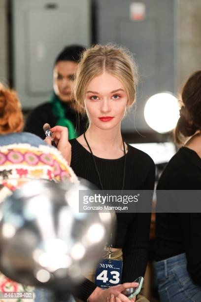 A model prepares backstage during the Badgley Mischka Fashion show during New York Fashion Week The Shows at Gallery 3 Skylight Clarkson Sq on...