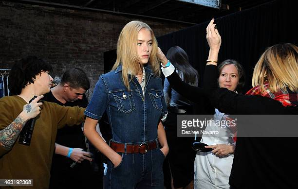A model prepares backstage during the FRAME Denim Presentation MercedesBenz Fashion Week Fall 2015 on February 11 2015 in New York City