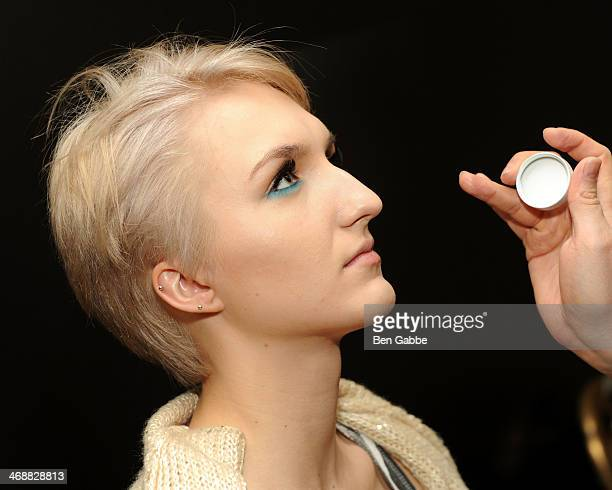 A model prepares backstage during the Geoffrey Mac For Sharon Needles fashion show at Out Hotel on February 11 2014 in New York City