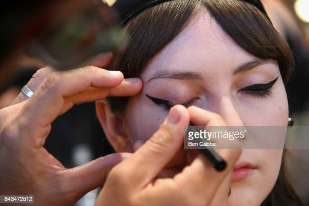 A model prepares backstage during the Greta Constantine Presentation at Pier 59 on September 6 2017 in New York City