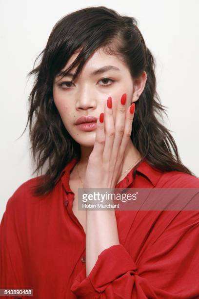 A model prepares backstage for Adam Selman fashion show during New York Fashion Week Presented By MADE at Gallery 2 Skylight Clarkson Sq on September...