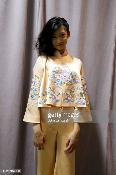 A model prepares backstage for Amelie Wang during New York Fashion Week The Shows at Industria Studios on February 09 2019 in New York City