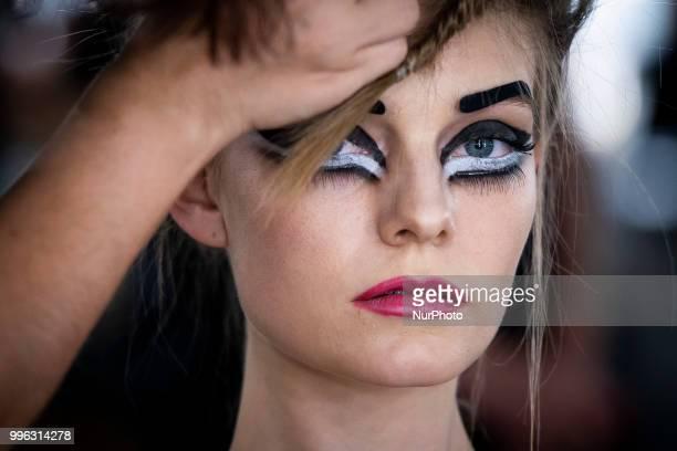 A model prepares backstage for 'Ana Locking' fashion show during MercedesBenz Madrid Fashion Week in Madrid Spain July 10 2018