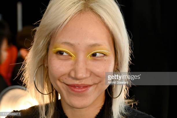 Model prepares backstage for Anna Sui during New York Fashion Week: The Shows at Gallery I at Spring Studios on September 09, 2019 in New York City.