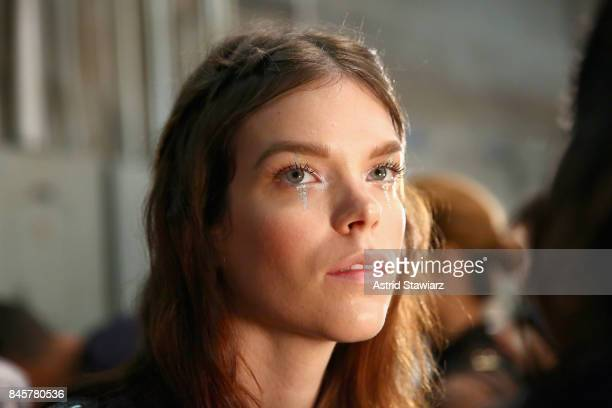 A model prepares backstage for Anna Sui fashion show during New York Fashion Week The Shows at Gallery 1 Skylight Clarkson Sq on September 11 2017 in...