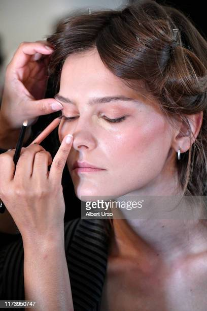 A model prepares backstage for Badgley Mischka during New York Fashion Week The Shows at Gallery I at Spring Studios on September 11 2019 in New York...