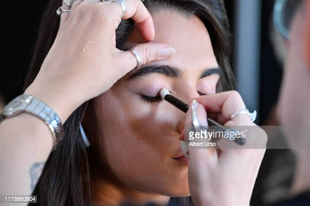 Model prepares backstage for Badgley Mischka during New York Fashion Week: The Shows at Gallery I at Spring Studios on September 11, 2019 in New York...