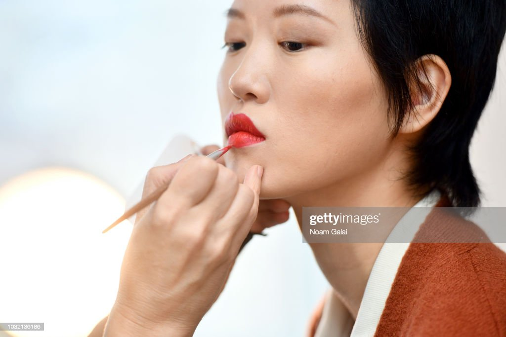 A model prepares backstage for Calvin Luo during New York Fashion Week: The Shows at Gallery I at Spring Studios on September 12, 2018 in New York City.