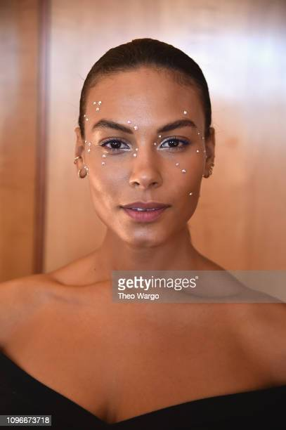 A model prepares backstage for Christian Siriano fashion show during New York Fashion Week The Shows at Top of the Rock on February 9 2019 in New...