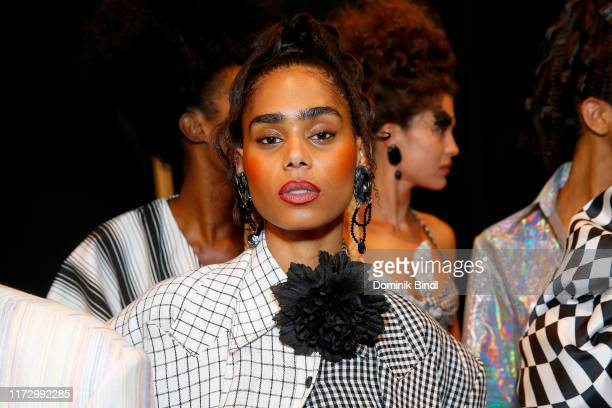 A model prepares backstage for Christopher John Rogers during New York Fashion Week The Shows at Gallery II at Spring Studios on September 07 2019 in...