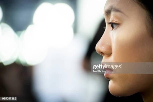 A model prepares backstage for 'Custo Barcelona' fashion show during MercedesBenz Madrid Fashion Week in Madrid Spain July 09 2018