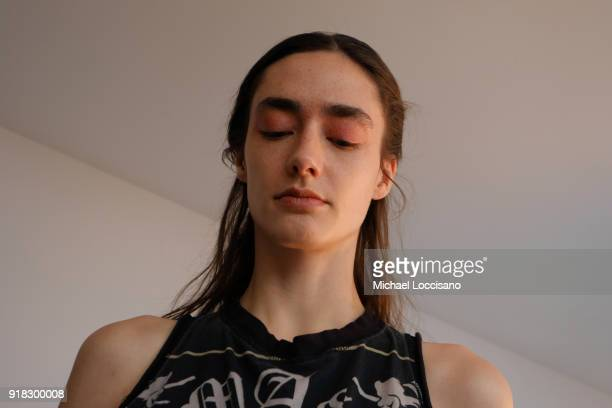 A model prepares backstage for Esteban Cortazar during New York Fashion Week The Shows at Gallery I at Spring Studios on February 14 2018 in New York...