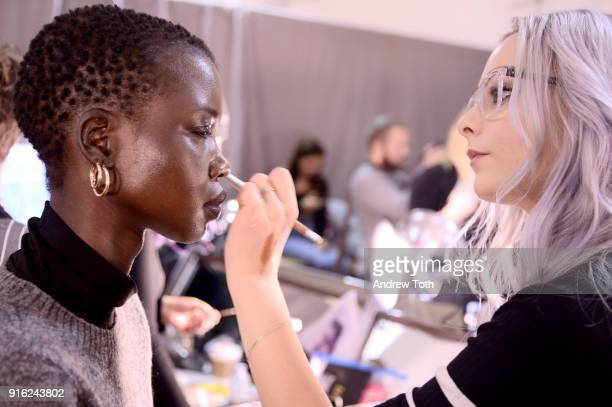 A model prepares backstage for Fashion Hong Kong during New York Fashion Week The Shows at Industria Studios on February 9 2018 in New York City