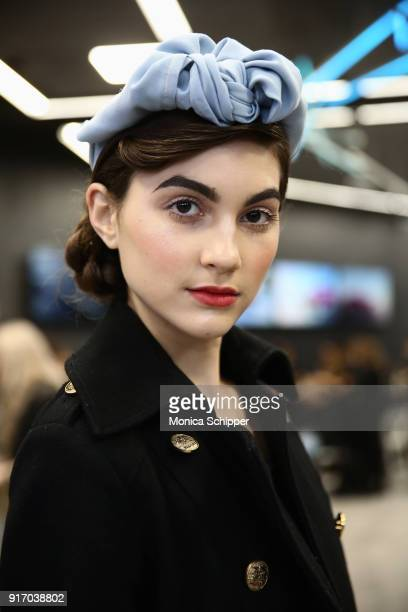 A model prepares backstage for Gemma Hoi during New York Fashion Week The Shows at MercedesBenz Manhattan on February 11 2018 in New York City