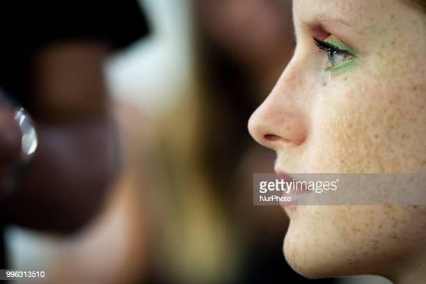 A model prepares backstage for 'Hannibal Laguna' fashion show during MercedesBenz Madrid Fashion Week in Madrid Spain July 10 2018