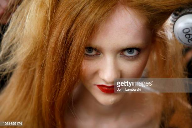 Model prepares backstage for Hogan McLaughlin during New York Fashion Week: The Shows at Gallery II at Spring Studios on September 11, 2018 in New...