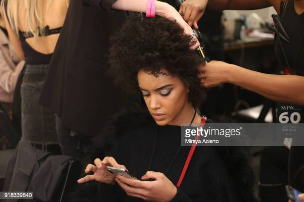 A model prepares backstage for Irina Vitjaz during New York Fashion Week The Shows at Gallery I at Spring Studios on February 14 2018 in New York City