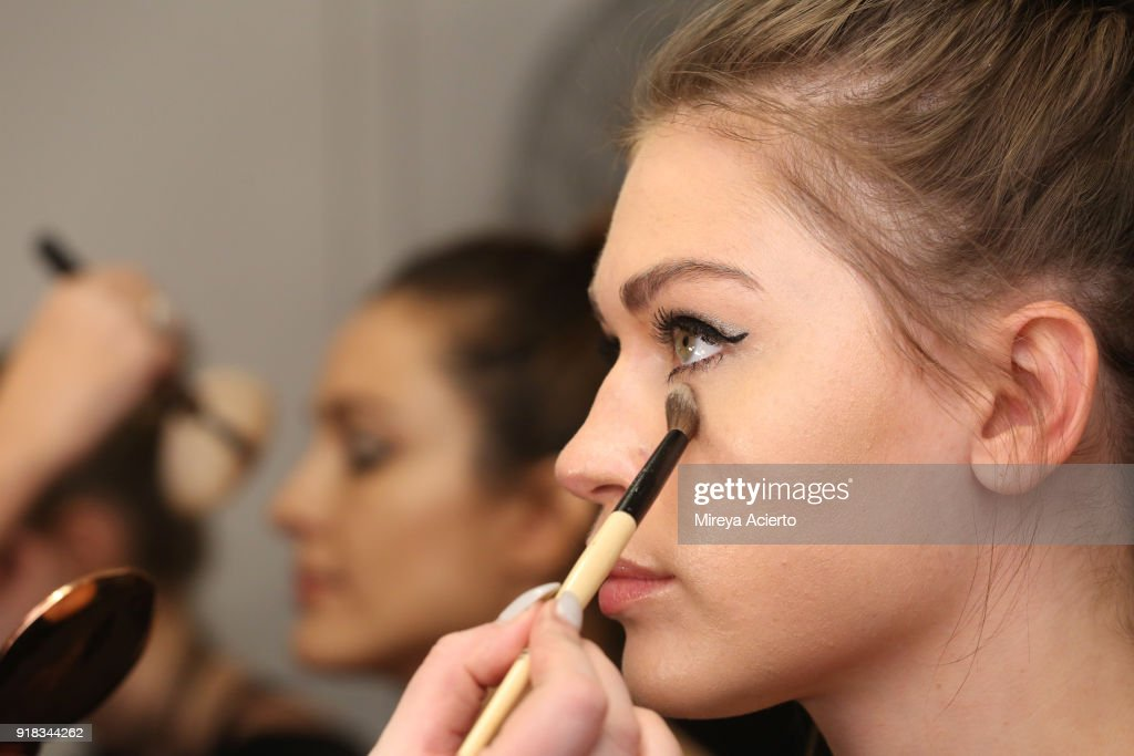 A model prepares backstage for Irina Vitjaz during New York Fashion Week: The Shows at Gallery I at Spring Studios on February 14, 2018 in New York City.