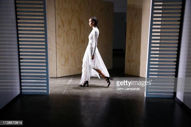 A model prepares backstage for Jonathan Simkhai show during New York Fashion Week The Shows at Industria Studios on February 09 2019 in New York City
